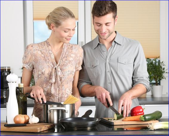couple cooking in their new kitchen design