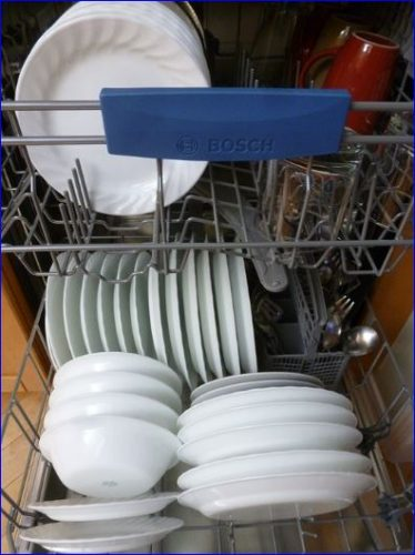 dishwasher loaded full of dishes